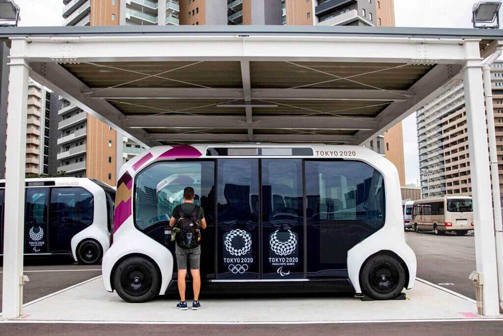 image showing the tokyo olympics 2020 using electric cars for the travel for the sustainablity | Agrrro