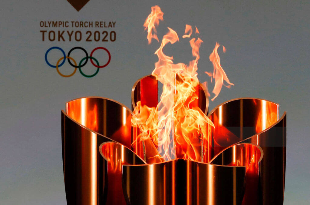 image showing the tokyo olympics 2020 using aluminium torch for tournament | Agrrro