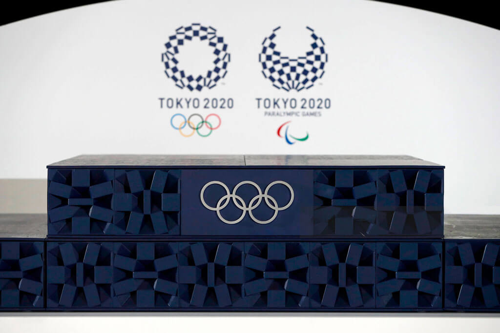 image showing the tokyo olympics 2020 using the plastc podium for giving rewards to winning athletes | Agrrro