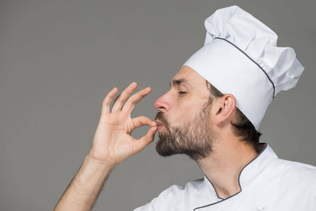 a male chef making a tasty posture to represent the taste of organic food | Agrrro
