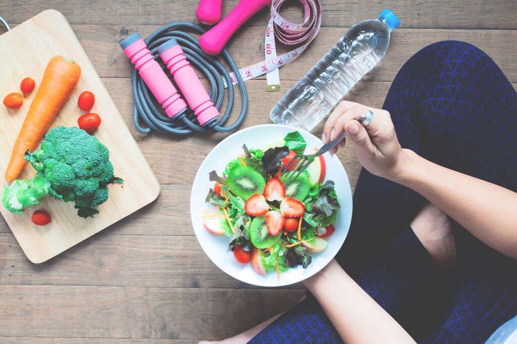 image showing girl eating organic food to maintain her health | Agrrro